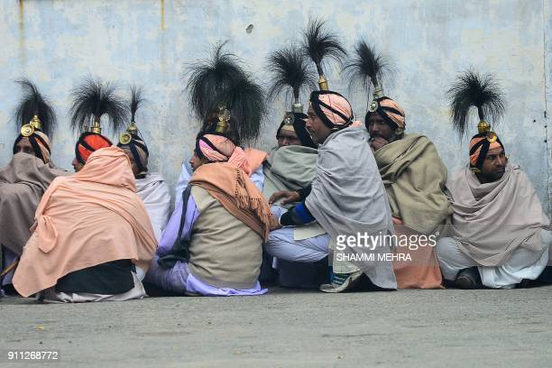 Indian Jangam monks rest after singing religious songs ahead of Maha Shivratri festival in Jalandhar on January 28 2018 The Hindu festival of Maha...