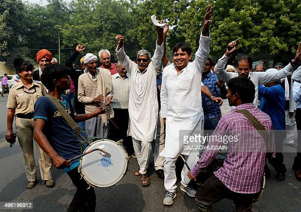Indian Janta Dal United activists and supporters celebrate after a victory by an alliance led by their party in New Delhi on November 8 in the Bihar...