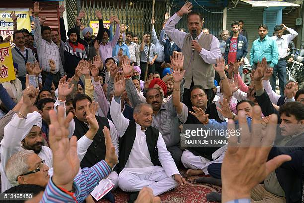Indian jewellers shout slogans during a protest against excise duties on gold in Amritsar on March 3 during a threeday nationwide strike by gold...