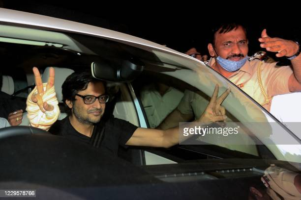 Indian Journalist and editorinchief of Republic TV Arnab Goswami flashes a victory sign from inside his car after his release from prison on granted...