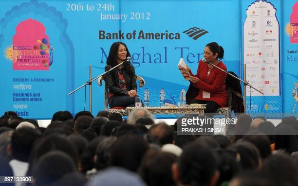 Indian journalist Madhu Trehan reads aloud from the book 'Tiger Mothers' by US author Amy Chua during the DSC Jaipur Literature Festival in Jaipur on...