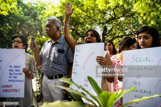 Indian journalists hold placard at a protest against sexual harassment in the media industry in New Delhi on October 13 2018 India's #MeToo movement...