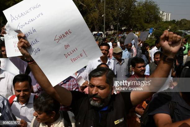 Indian journalists stage a protest next to the Indian Parliment at a demonstration over an alleged assault by police on two female reporters in New...
