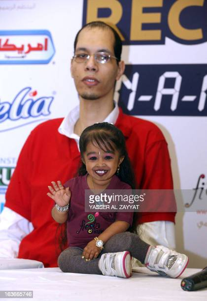 Indian Jyoti Amge the world's shortest woman sits next to Morocco's Brahim Takioullah who has the largest feet in the world according to the Guinness...