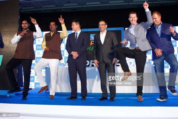 Anup kumar stock photos and pictures getty images indian kabaddi players rahul chaudhari anup kumar pose with kent cheng ceo vivo india sanjay gupta thecheapjerseys Gallery
