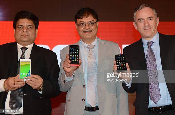 Indian Karbonn mobile Chairman Sudhir Hasija Managing Director Pardeep Jain and MediaTek General Manager of International Sales Finbarr Moynihan hold...