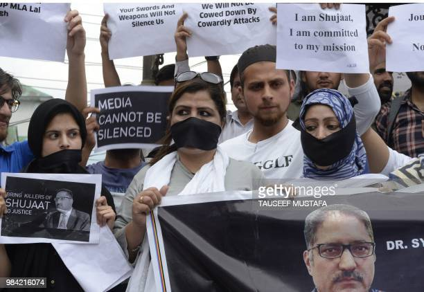 Indian Kashmiri journalists stage a protest against the killing of veteran journalist Shujaat Bukhari and recent remarks by Bharatiya Janata Party...