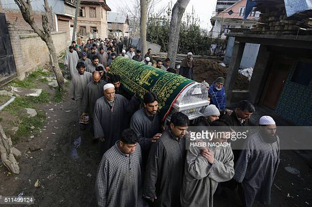 Indian Kashmiri men carry a coffin during a funeral for civilian Abdul Gani in Gundipora village in Pulwama district south of Srinagar on February 21...