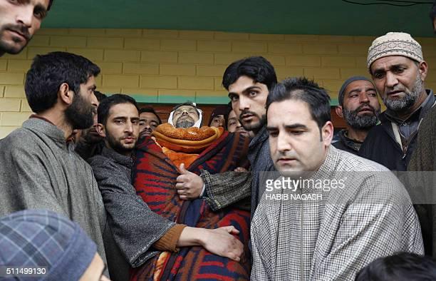 Indian Kashmiri men carry the body of civilian Abdul Gani in Gundipora village in Pulwama district south of Srinagar on February 21 2016 Gani was hit...