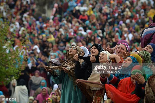 Indian Kashmiri Muslims pray before a priest shows a relic believed to be hair from the beard of Prophet Muhammed during special prayers on the death...