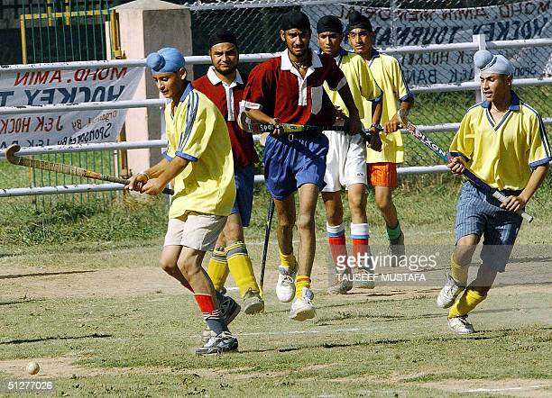 Indian Kashmiri Sikh students play field Hockey at a ground close to the official residence of Kashmir's chief minister Mufti Mohammed Sayeed, in...