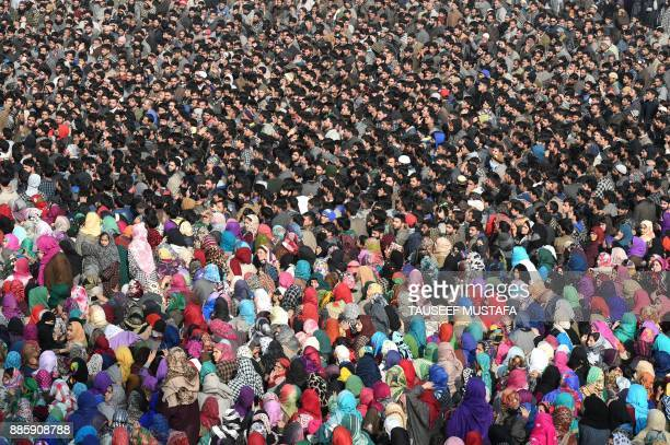 TOPSHOT Indian Kashmiri villagers shout proindependence slogans during a funeral procession for a local militant Yawar Bashir at Hablish village in...