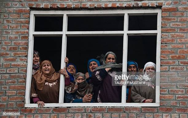 Indian Kashmiri women cry during the funeral for a college student who was found dead near railway tracks in Srinagar on January 14 2016 Police fired...