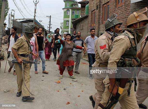 Indian Kashmiris protest as police carry away the body of a youth from outside a hospital in Srinagar on July 9 2016 Clashes spread across the...