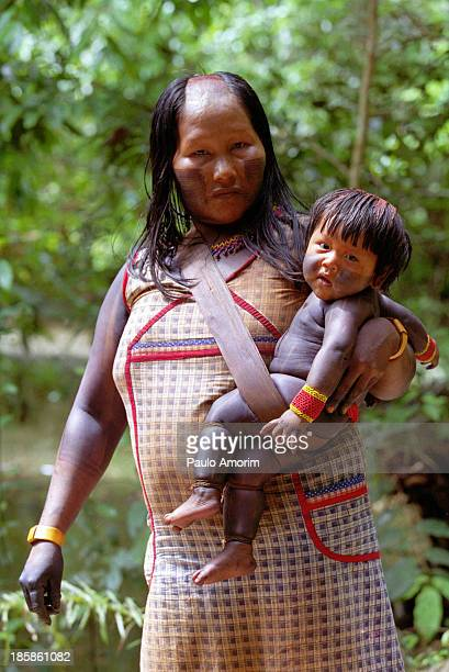 Indian Kayapo mother with her baby at forest on 22 June, 2001. - PHOTO BY PAULO AMORIM