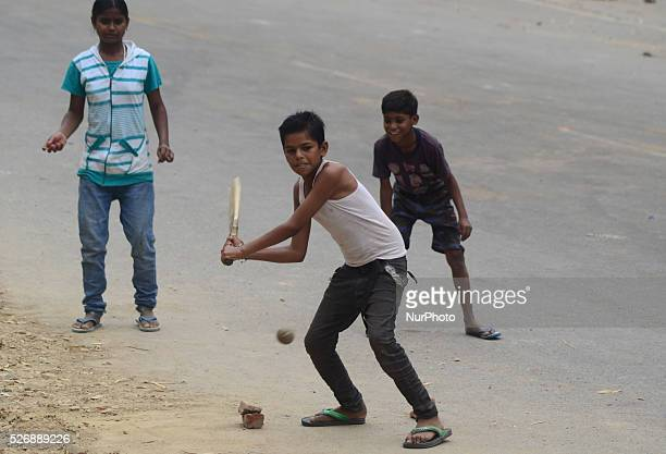 Indian kids play cricket in the streets of Allahabad on March 27 2016