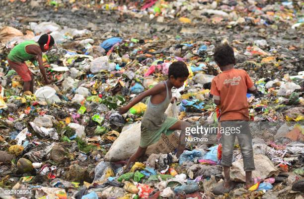 Indian kids search for reuseable items on World Environment day at a Municipal waste dumping site in Dimapur India north eastern state of Nagaland on...