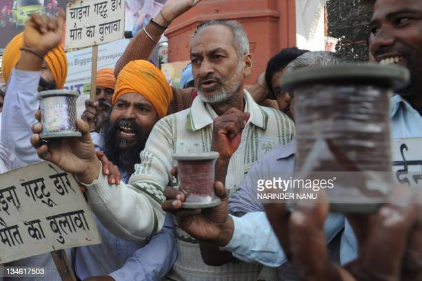 Indian kite and thread makers holds Chinesemade kite string during a protest in Amritsar on December 3 2011 Last year the district administration...