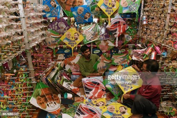 Indian kite maker Salimbhai Rasulbhai Patangwala shows kites with photos of Indian Prime Minister Narendra Modi and Congress Vice President Rahul...