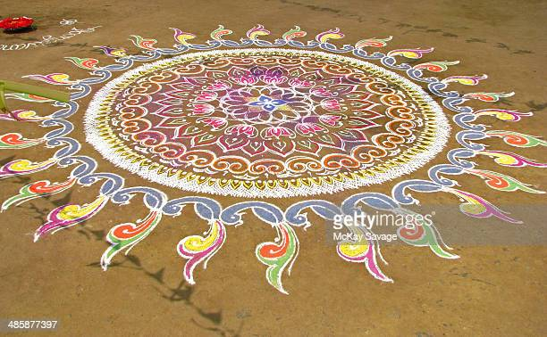 indian kolam chalk art design - rangoli stock pictures, royalty-free photos & images