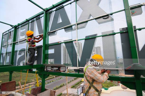 Indian Labor work a road side hoarding on June 022017 in KolkataIndiaThe taxation process for the advertising agencies can get complicated with the...
