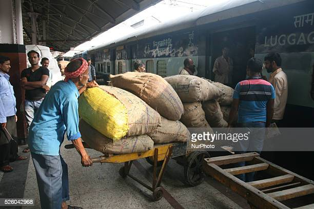 Indian laborers unload goods from a train at a railway station in Howrah Kolkata India on 25th February 2016