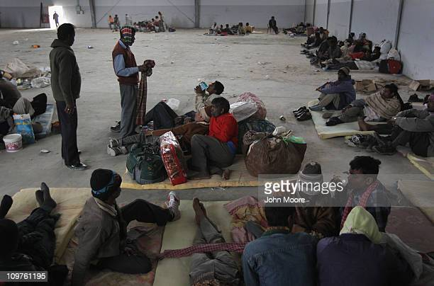 Indian laborers wait at the port of Benghazi for a ship out of the country on March 4 2011 in Benghazi Libya Thousands of foreign laborers continue...