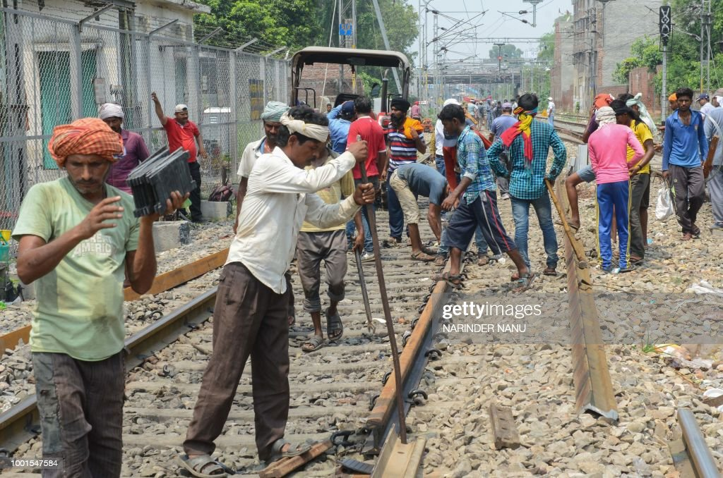 Indian labourer repair a railway tracks at Amritsar station in Amritsar on July 19 2018 A changeover to an electronic interlocking system instead of..