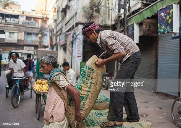 indian labourers carry sacks - wages stock pictures, royalty-free photos & images