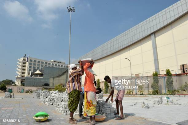 Indian labourers work in front of Hyderabad International Convention Centre during preparations ahead of the Global Entrepreneurship Summit in...