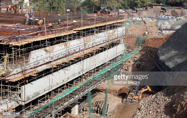 Indian labourers work on a construction multilevel parking complex in Jammu on Feburary 1 2018 India in its annual budget February 1 expanded its...