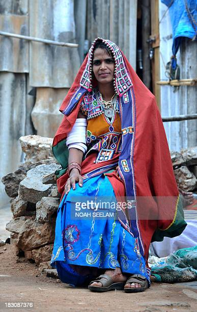 Indian Lambadi or Banjara tribal woman Ramavathu Shanthi Bai poses at her home in Hyderabad on October 9 2011 Shanthi Bai 34 years old a daily...