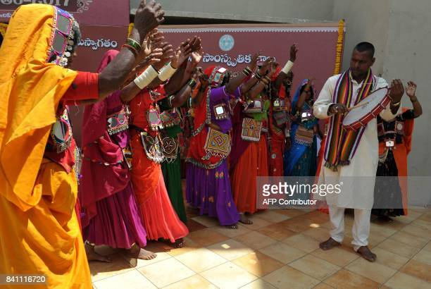 Indian Lambadi tribal women dance to drum beats at the folk arts festival Janapada Jatara in Hyderabad on August 31 2017 The southern Indian state of...
