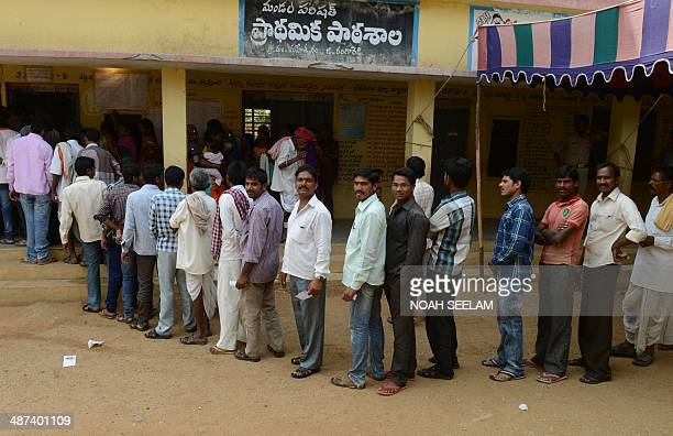 Indian lambadi tribespeople queue to cast their ballots at a polling station at Rangareddy on the outskirts of Hyderabad on April 30 2014 India's...