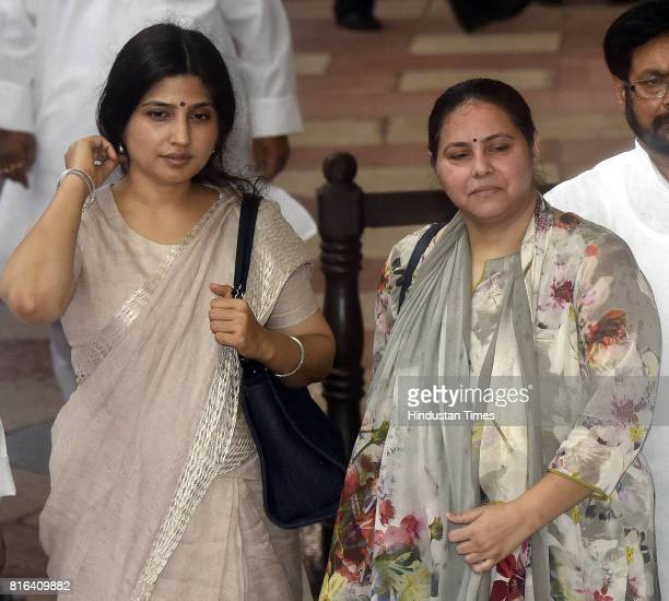 Indian lawmakers Dimple Yadav and Misa Bharti after casting their votes during the presidential election at the Parliament House on July 17 2017 in...