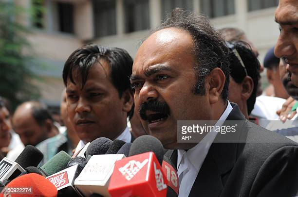 Indian lawyer Amrish Patel,representing some riot victims speaks to the media representatives in the Trial Court compound in Ahmedabad on August 29...