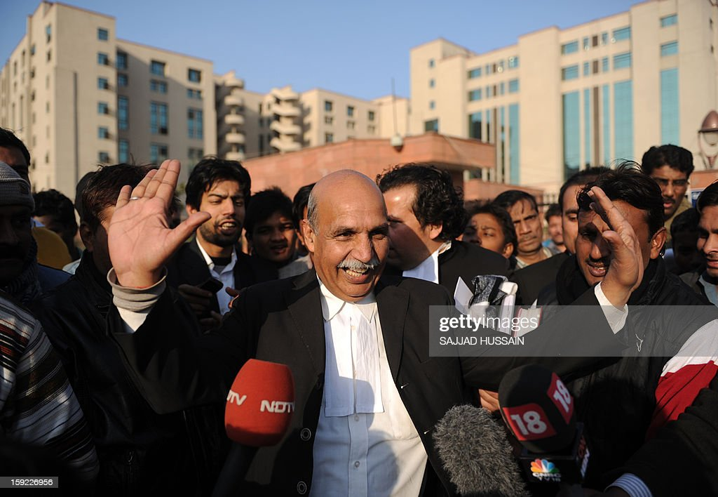 Indian lawyer V.K. Anand (C), who represents defendant Ram Singh who is on trial for the gang-rape of a student, gestures as he speaks with the media outside the Saket District Court in New Delhi on January 10, 2013. A lawyer for the defendants in the New Delhi gang-rape case accused police on January 10 of beating confessions out of them as they appeared for their second court appearance.