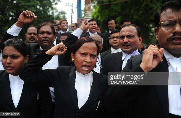 Indian lawyers working at the Allahabad high court shout slogans at a protest against Bharatiya Janata Party official Dayashankar Singh who was...