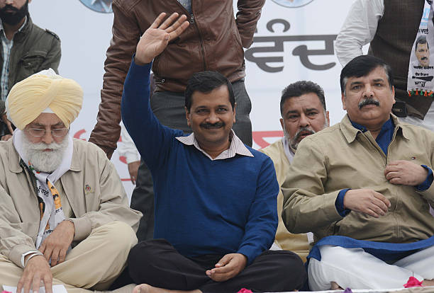 Indian leader of the Aam Aadmi Party and Chief Minister of Delhi Arvind Kejriwal and AAP leaders Inderbir Singh Nijjar and Sanjay Singh pose for a...