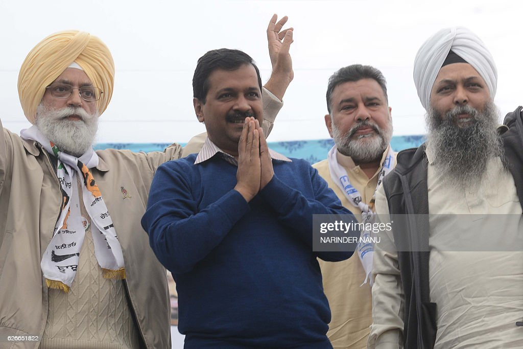 Indian leader of the Aam Aadmi Party and Chief Minister of Delhi Arvind Kejriwal and AAP leader Inderbir Singh Nijjar pose for a photograph with...