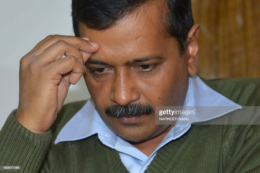 Indian leader of the Aam Aadmi Party and Chief Minister of Delhi Arvind Kejriwal listens during a press conference in Amritsar on December 30 2016 /..