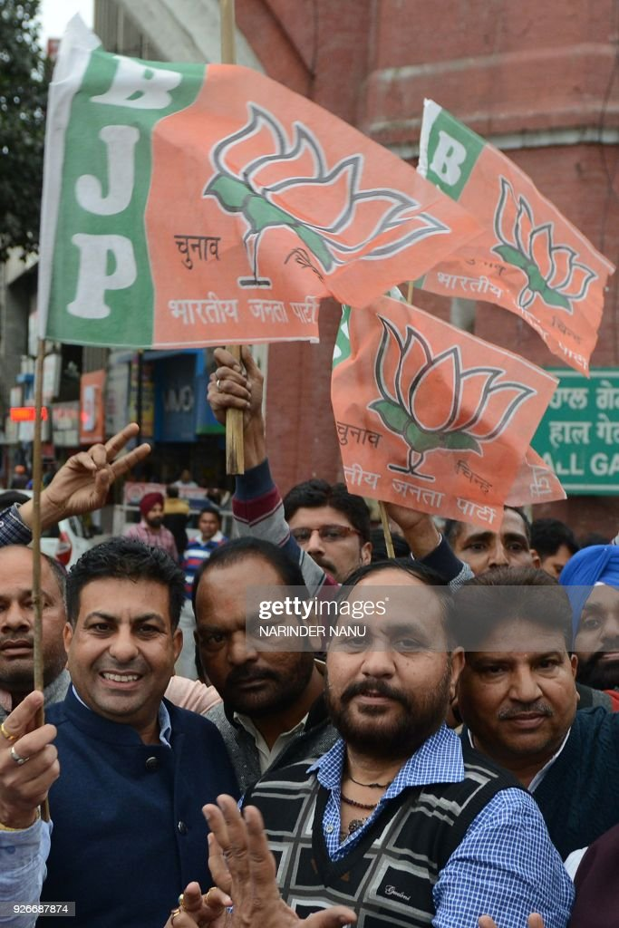Indian leaders and supporters of the Bharatiya Janata Party celebrate the party`s victory in the northeast region in Amritsar on March 3 2018 Indian..