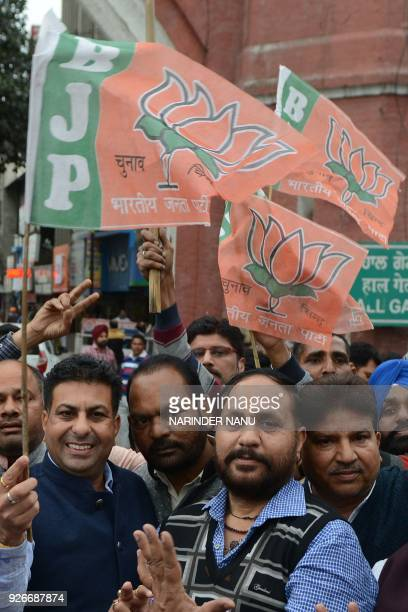 Indian leaders and supporters of the Bharatiya Janata Party celebrate the party's victory in the northeast region in Amritsar on March 3 2018 Indian...