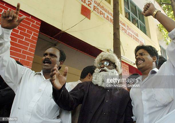Indian leftwing activists shout slogans against Hindu religious leader Jayendra Saraswathi after they were arrested outside Madras High Court in...
