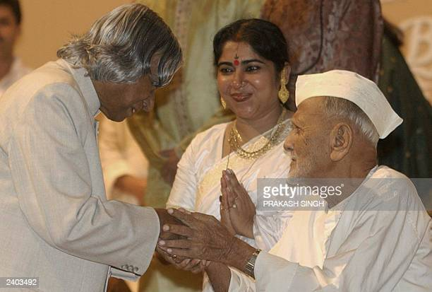 Indian Legendary flautist Bismillah Khan greets Indian President A P J Abdul Kalam as singer Soma Ghosh looks on before a concert at the Parliament...
