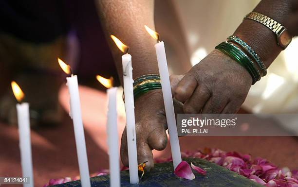Indian leprosy patients light candles in rememberence of Police officials who died in the Mumbai terror attacks in Mumbai on December 26 2008 A month...