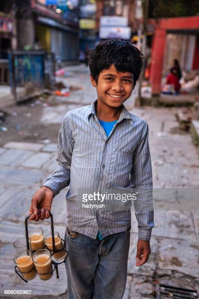 indian little boy selling chai on streets of kathmandu, nepal - chai stock photos and pictures