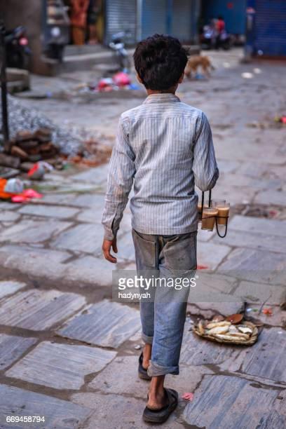 Indian little boy selling chai on streets of Kathmandu, Nepal