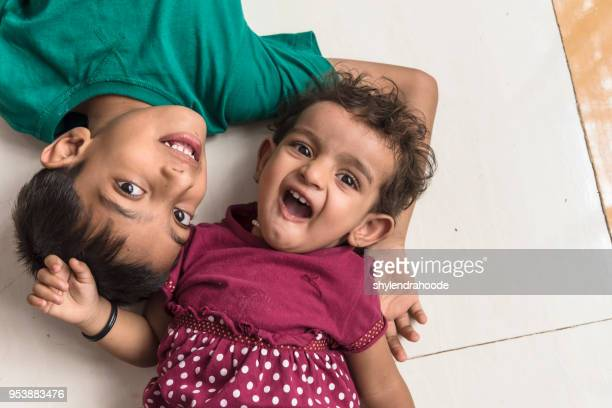 indian little brother and sister having fun - indian girl kissing stock photos and pictures
