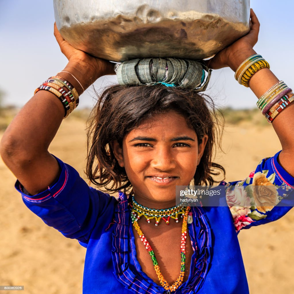 Indian Little Girl Carrying On Their Heads Water From Well Stock ...